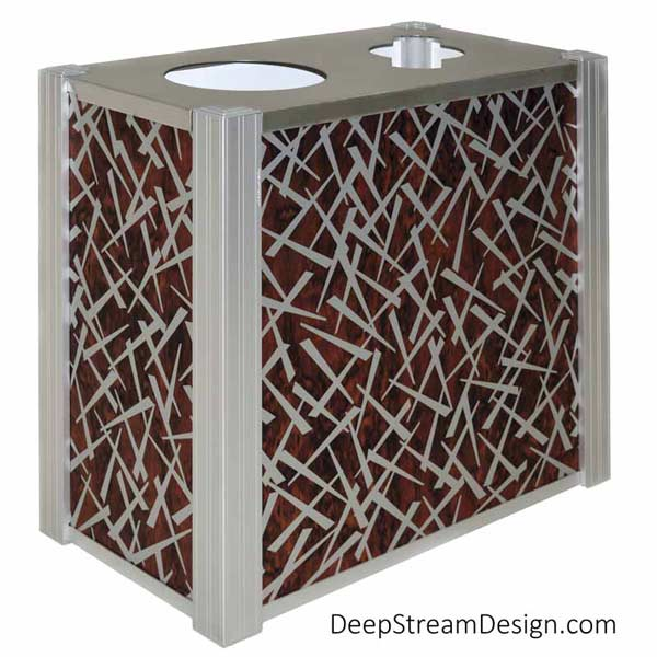 A studio photo of an Audubon dual-stream Modern Commercial Combined Recycling and Trash Receptacle with side panels using ATI Laminates Fusion Aluminum Panel with the Chopstix pattern printed in silver on dark cherry wood background as a panel option.