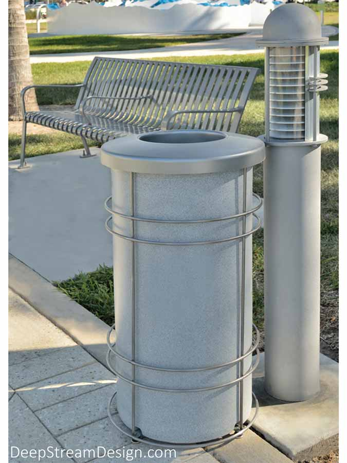 Pictured in use at a museum beachfront park, the rugged, timeless Nautique modern Round Trash Bin is perfect for harsh outdoor conditions like yacht clubs, beach bars, even ski areas. The heavy-duty 24-gallon UV-proof HDPE bin and lid may be pressure cleaned for sanitation and used with or without a lid.