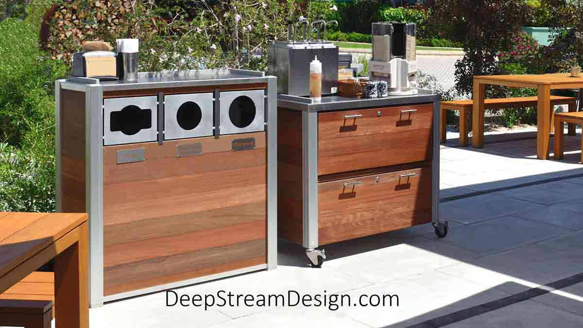Outdoor Restaurant Food Service Cabinetry and Fixtures like the outdoor food service carts on wheels with 2 storage drawers and a 316-stainless steel top for condiments shown here with its companion piece, a commercial combined recycling and trash receptacle, also constructed with exterior grade waterproof Ipe Wood with a stainless-steel top, create an upscale atmosphere for this tropical island outdoor restaurant with seating and take-out service.