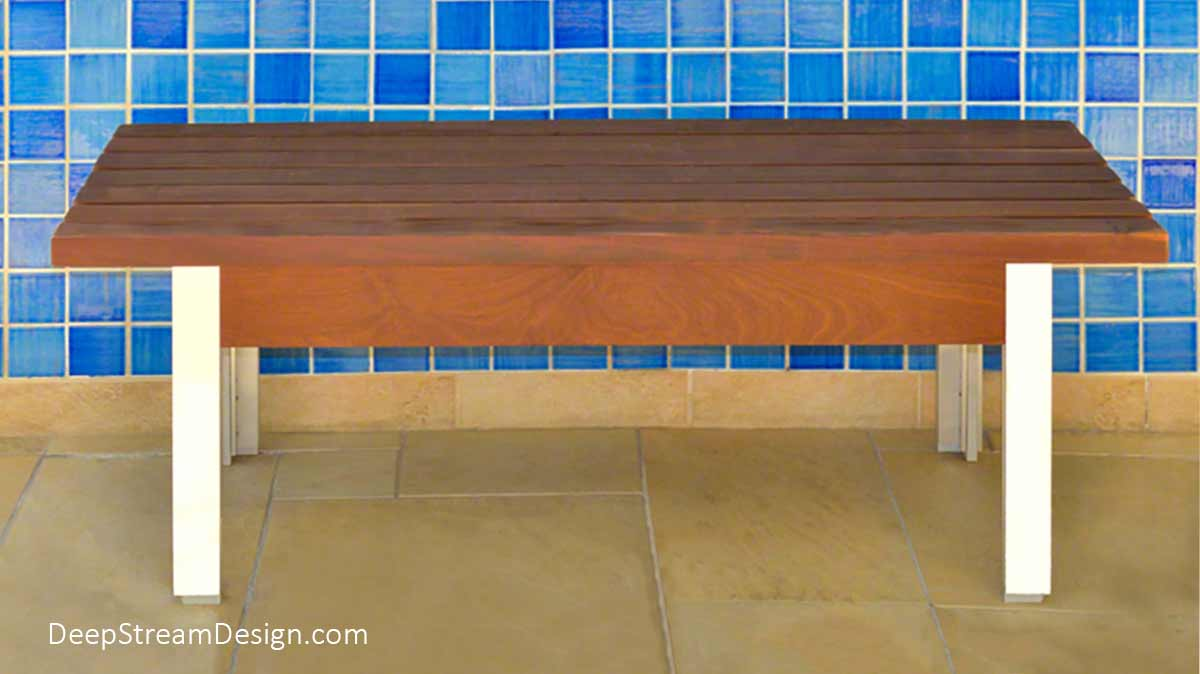 """The Perfect Gallery Bench, a modern anodized aluminum and wood minimalist style """"Museum Bench"""" with a hidden interior aluminum frame photographed against an dark blue and sky blue iridescent glass tile wall"""