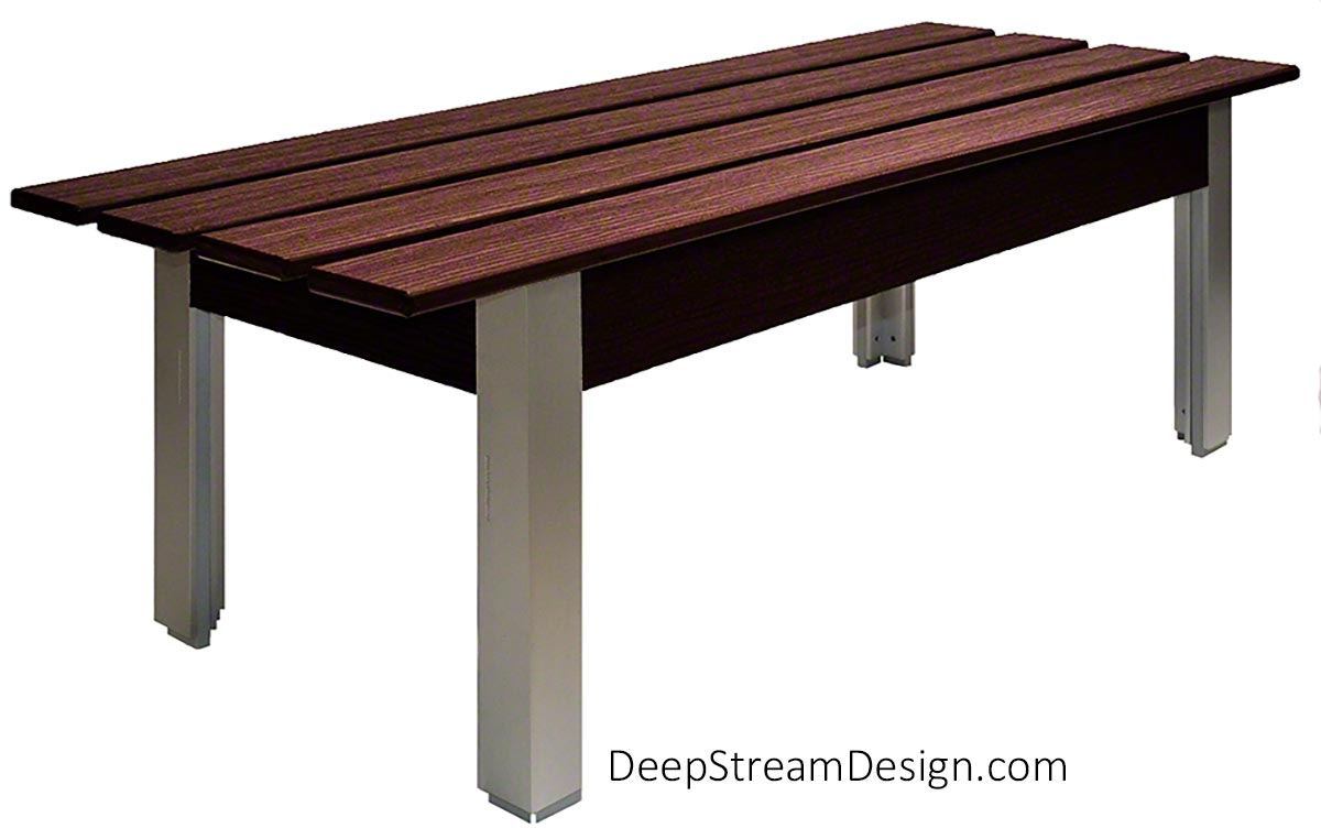 Studio photograph taken from the side showing The Perfect Outdoor Bench with non-marking feet, Ipe Brown-colored waterproof, UV-proof recycled plastic lumber slat seat, and anodized silver aluminum legs.