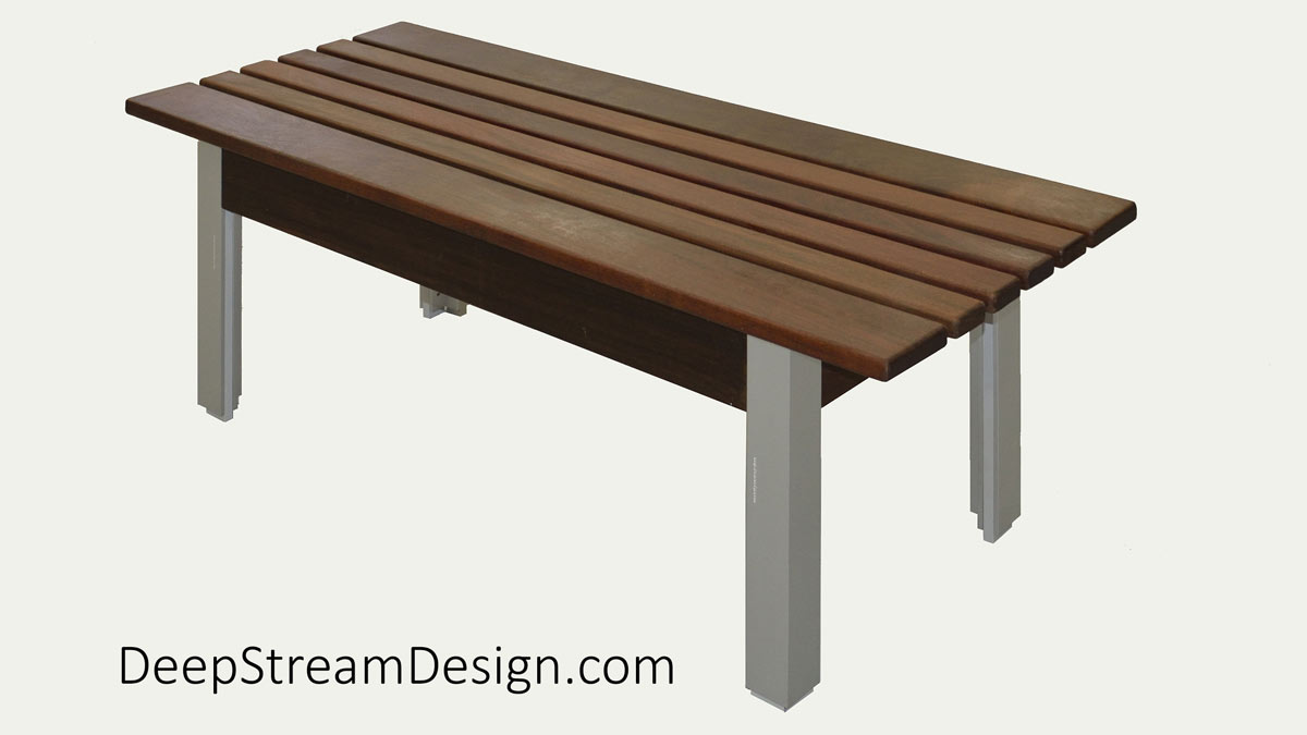 Studio photograph of The Perfect Outdoor Bench with non-marking feet, Ipe Tropical hardwood seat, and anodized silver aluminum legs.