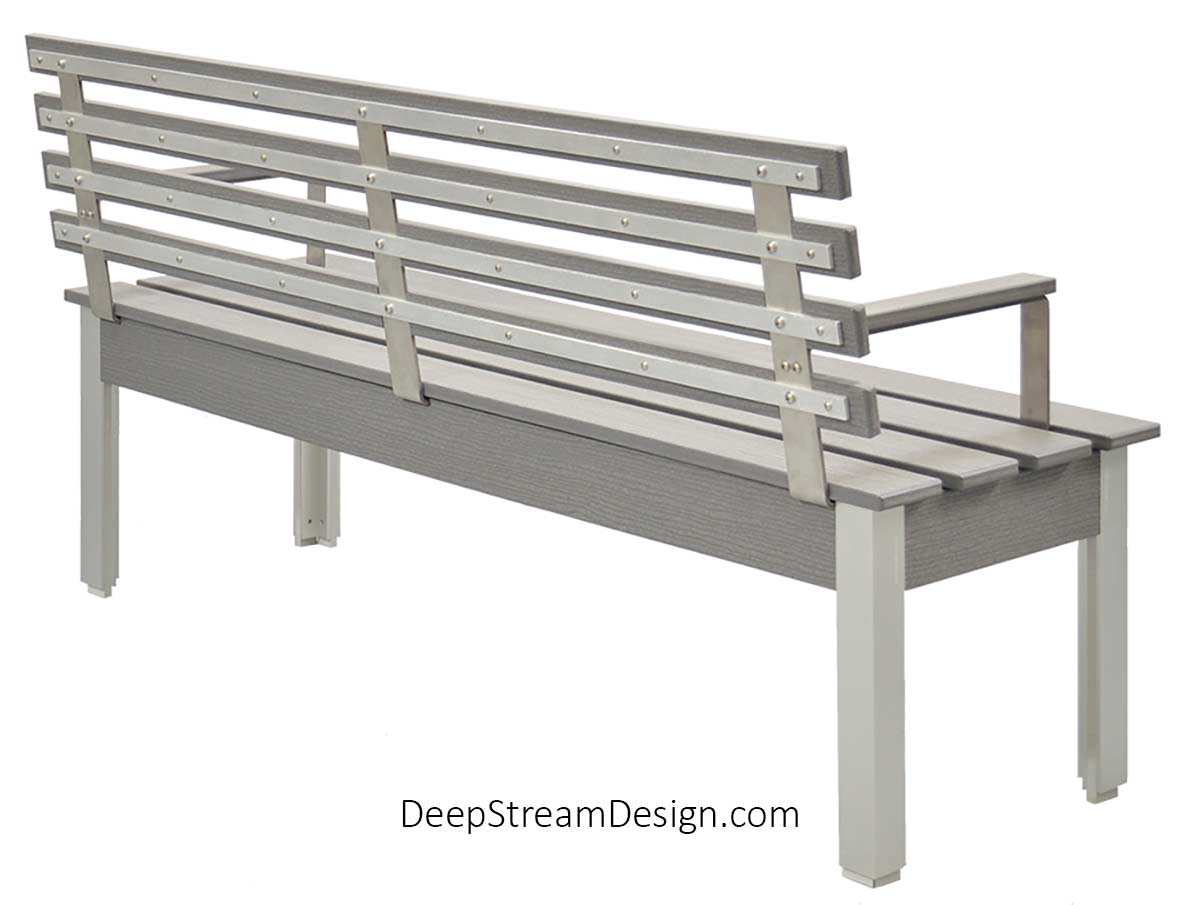 Studio photo from the back showing The Perfect Outdoor Bench with Back and arm rests with a 60-inch slatted seat crafted with Cement Gray colored no-maintenance recycled plastic lumber, marine anodized sliver aluminum legs. There are three vertical 316 stainless steel back supports attached to four horizontal aluminum reinforcing flat bars behind the four planks of recycled plastic that create the ergonomic back rest.