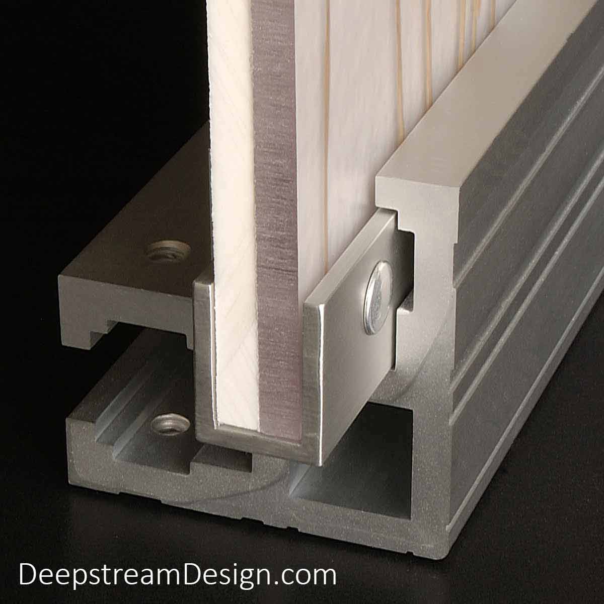 A studio photo showing the Audubon Structural Architectural Aluminum Frame System L extrusion holding a slide-in-easy composite panel in the L extrusions Channel Acceptance Slot. The composite panel in this example was created with a 3form Eco-resin panel backed by a white panel with both captured inside the Audubon systems U-channel extrusion and held in place by aluminum post screws.