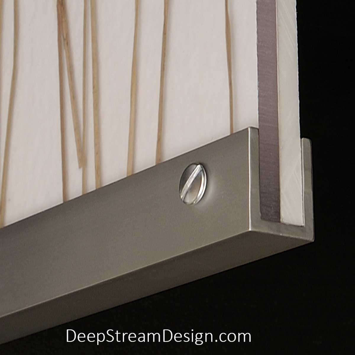 A Studio photo of a proprietary Audubon Aluminum Frame System U-channel creating a composite panel combining an expensive 3form Eco-resin panel with an inexpensive white panel in the background.