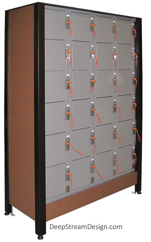 Studio photo showing a custom crafted Deluxe Athletic Club Locker Cabinet, created with DeepStream's proprietary bronze marine anodized aluminum extrusions and Ipe Brown colored recycled plastic lumber, to hold 4 banks of small, keyed lockers that are 6 lockers high. The locker Cabinets encloses the lockers on 3 sides, top and bottom, only leaving the front of the lockers exposed for their doors to open. The Locker Cabinet raises the Athletic Club Lockers up off the floor by 12 inches with the anodized aluminum legs resting on stainless-steel adjustable feet.