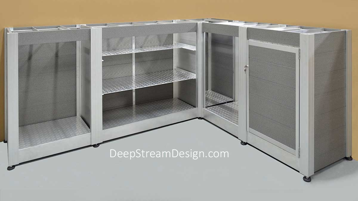 Studio picture showing a large L shaped Valet Parking Stand from the back side constructed with DeepStream's proprietary marine anodized aluminum frame, maintenance free light grey recycled plastic lumber planks. The countertop has been removed to show the aluminum flat bar and angle supports for the 316-stainless steel countertop. The entire cabinet is raised up on stainless-steel adjustable feet. There is room on the backside for a mini-fridge, key lockers with hidden compartment, computers, and the trash bins on shelves of aluminum diamond plate and cabinet doors of recycled plastic lumber.