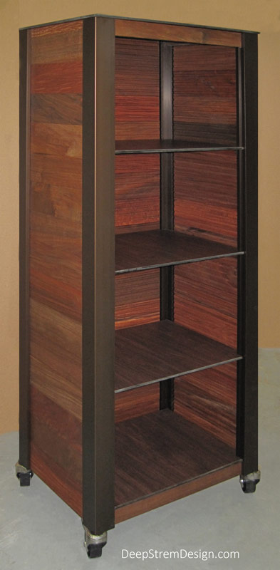 """Studio photo showing an Ipe tropical hardwood Multi-use Outdoor Restaurant Cabinet with four equally spaced replaceable Cocobala wood-look waterproof phenolic shelves. As all DeepStream modern commercial resort, spa, hotel, and restaurant fixtures are custom, a similar fixture can be crafted in any dimension up to 12 feet. The height of this 24"""" x 18"""" outdoor cabinet is 66"""" and it is crafted with bronze-anodized aluminum legs supported by optional stainless steel casters with polyolefin wheels."""
