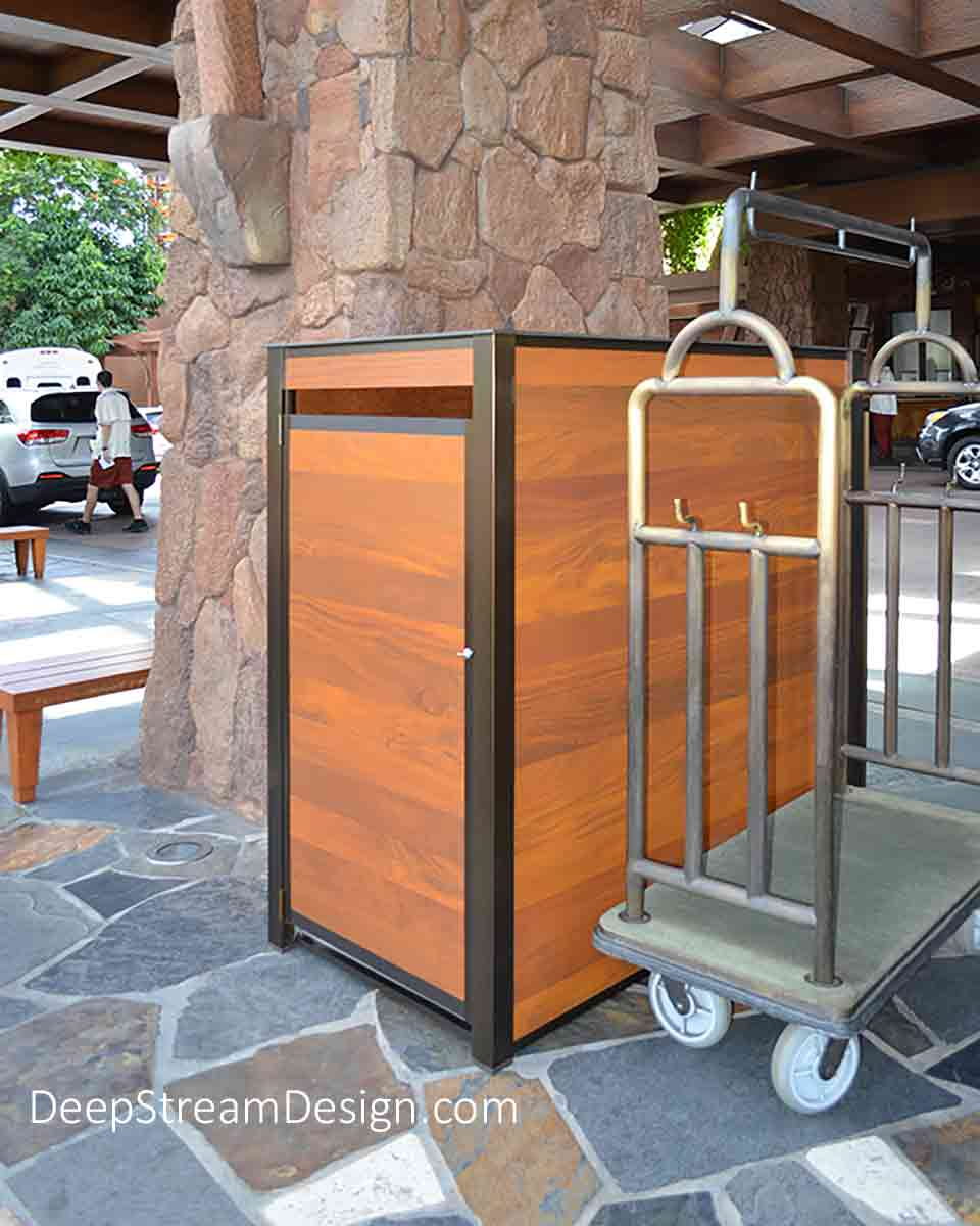 A large freestanding weatherproof Cumaru tropical hardwood storage cabinet pictured outdoors at a resort ready to store luggage or food deliveries for self-catering cottages at this Hawaiian resort. This large waterproof storage cabinet is constructed with DeepStream's proprietary bronze anodized aluminum extrusions, an aluminum frame, Cumaru wood and an interior floor of waterproof HDPE plastic, with a 316 stainless steel top. Options include adjustable stainless steel leveling feet.