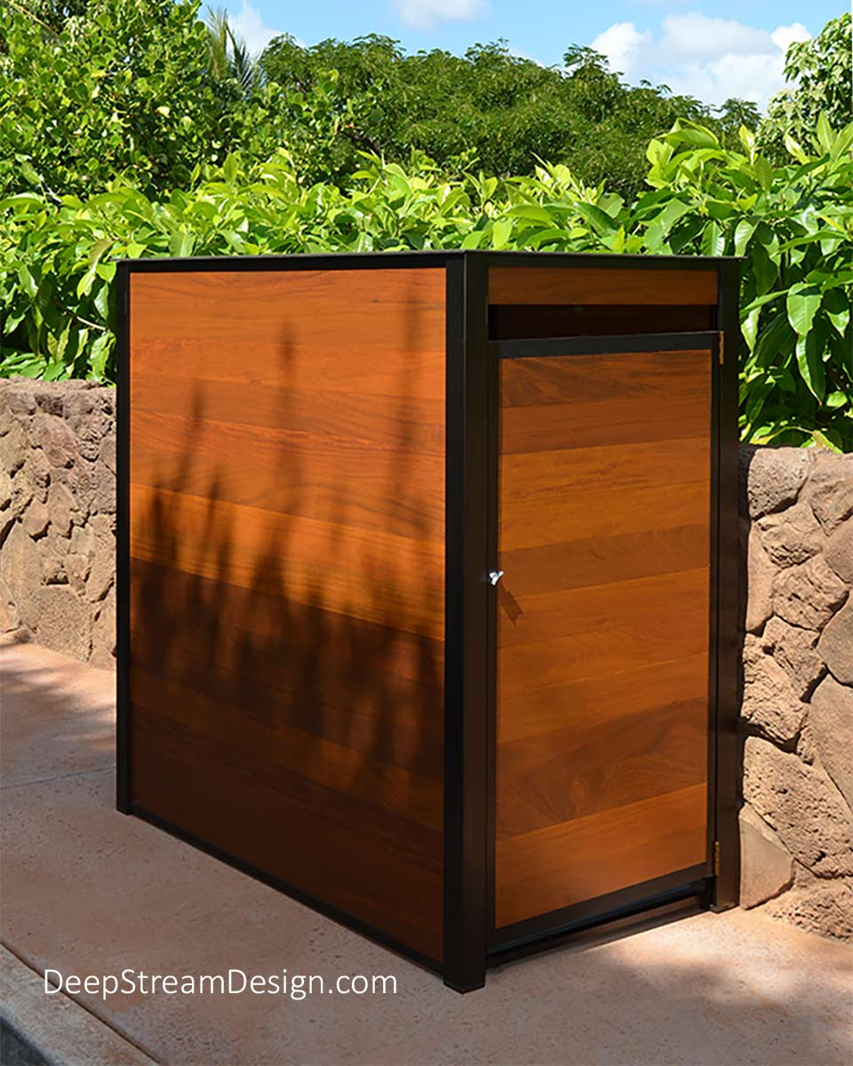A large freestanding weatherproof Cumaru tropical hardwood storage cabinet pictured outdoors at a resort ready to store luggage or food deliveries for self-catering cottages at this Hawaiian resort. This large waterproof storage cabinet is constructed with DeepStream's proprietary bronze-anodized aluminum extrusions, an aluminum frame, Cumaru wood, and an interior floor of waterproof HDPE plastic, with a 316 stainless steel top. Options include adjustable stainless steel leveling feet.