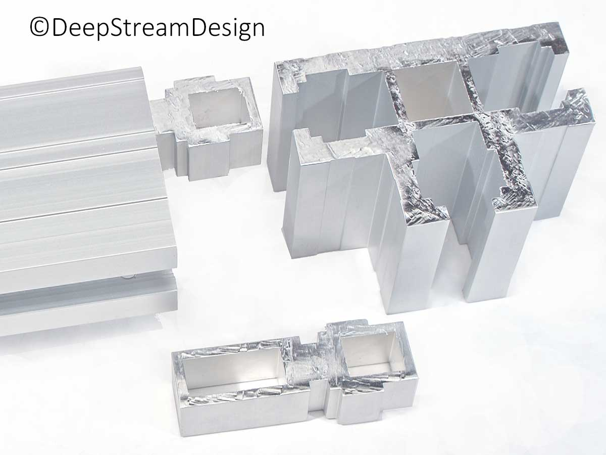 Studio photos showing an example of the Track-To-Void component of the Audubon proprietary anodized Structural Architectural Aluminum Frame System used to quickly connect one primary extrusion to another. Here the track-to-void connector is inserted in a Terminal extrusion ready to connect to a T extrusion by sliding the connector into the channel acceptance slot.