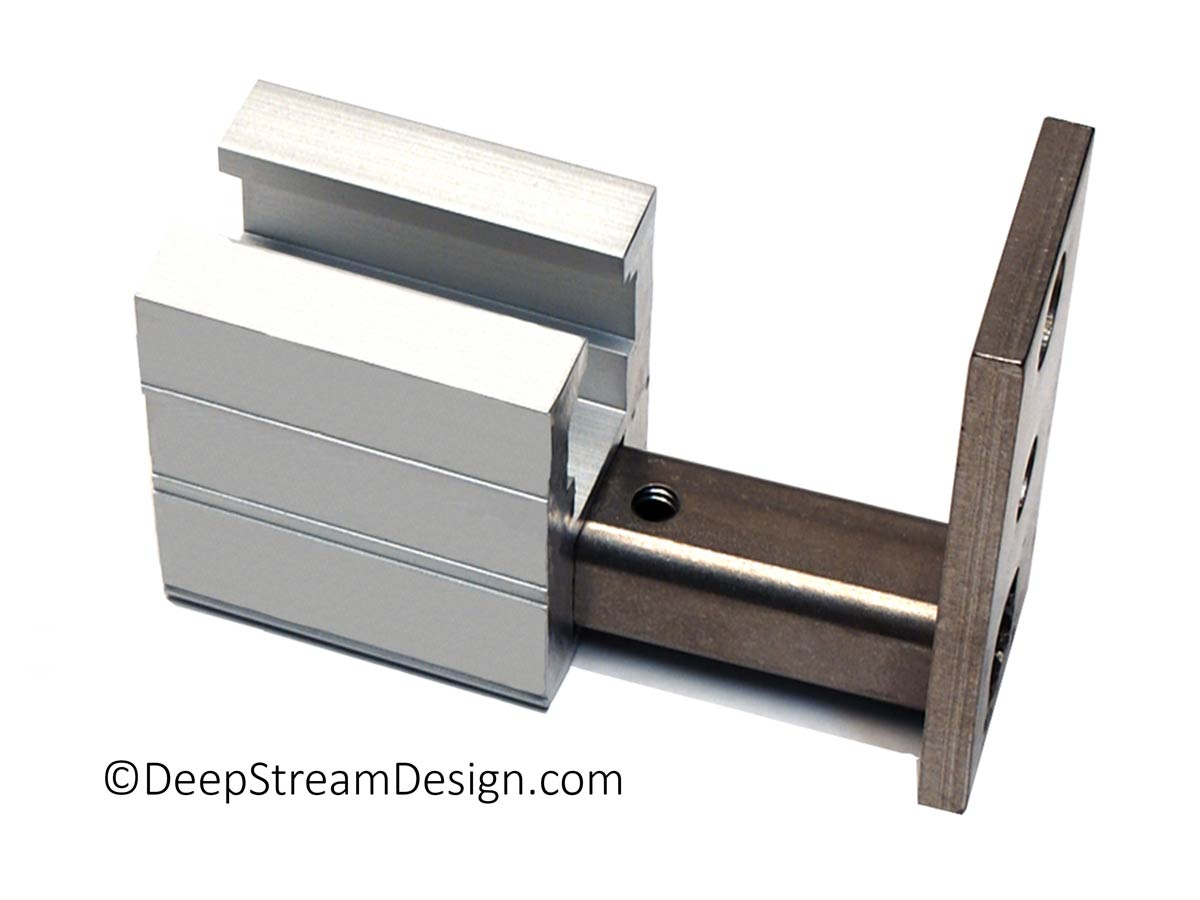 A studio photo showing how the 316-stainless steel mounts are inserted into the void in any Structural Architectural Aluminum Frame System primary extrusion, in this example it is a terminal leg.