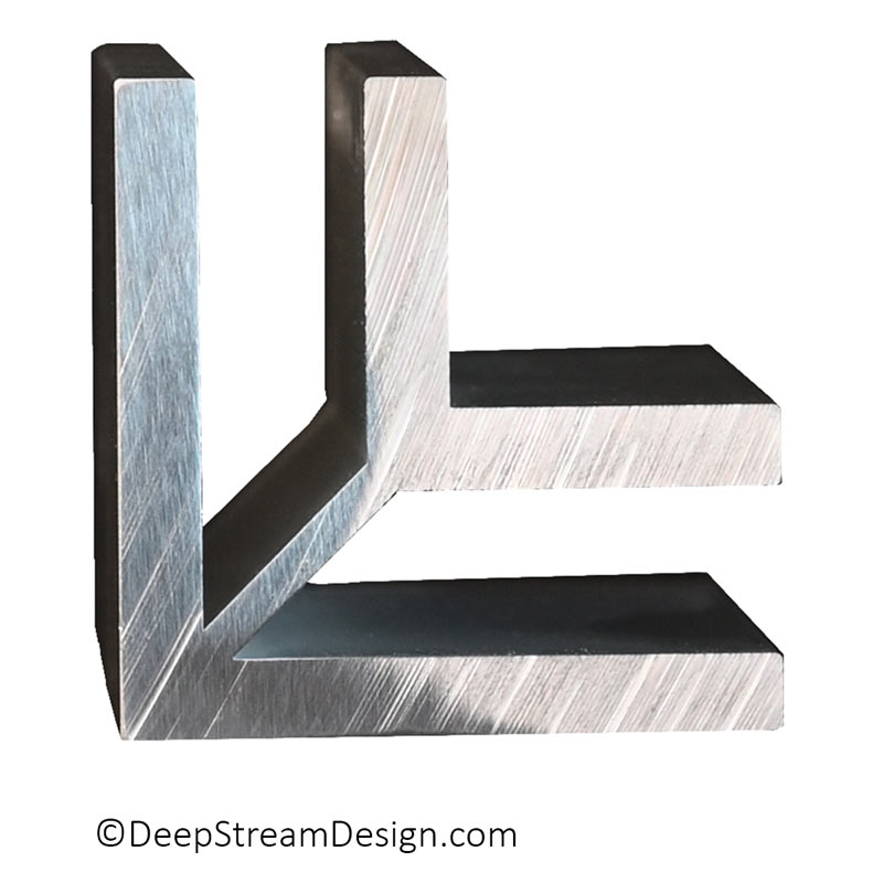 A studio photo looking at an anodized end section of a Mariner Structural Architectural Aluminum Frame System L corner extrusion typically used to join two panels at 90 degrees to create a structural frame for walls or planters