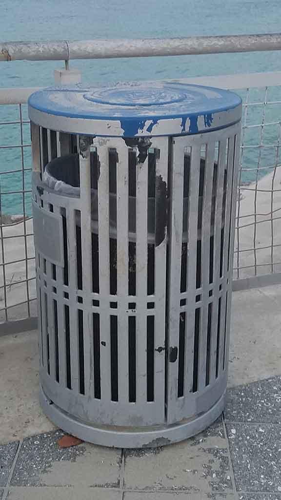 Powder coated aluminum trash bin deteriorating.