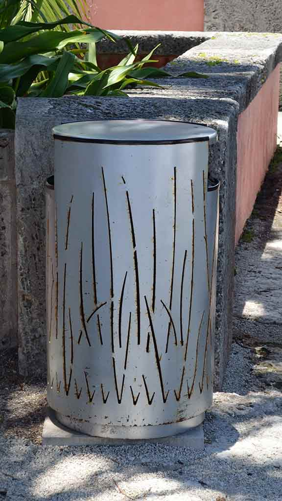 Rusting steel trash bin
