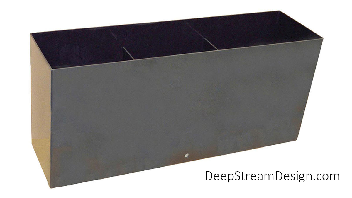 A studio photo showing the construction of a tall rectangular custom Waterproof Planter Liner with internal supports.